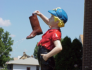 Photo of Boy with Boot Statue